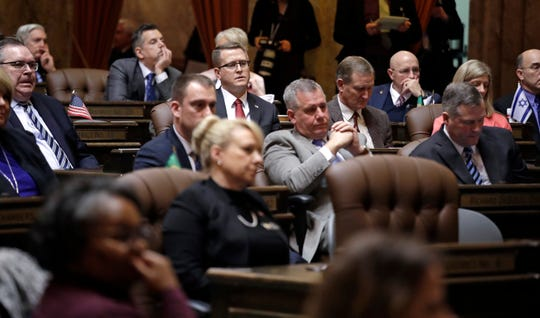 Legislators listen to Gov. Jay Inslee's State of the State address Tuesday in Olympia.