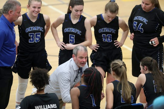 Olympic girls basketball coach Bryan Hanley and the Trojans face Kingston on Thursday with a Class 2A West Central District playoff berth on the line.