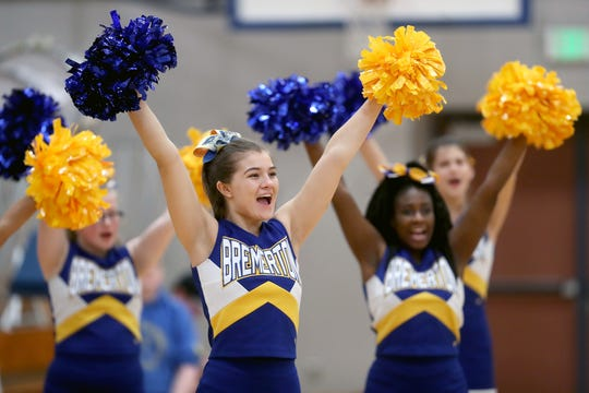 Bremerton senior Haley Michaelson cheers during a girls basketball game against Olympic on Jan. 15.