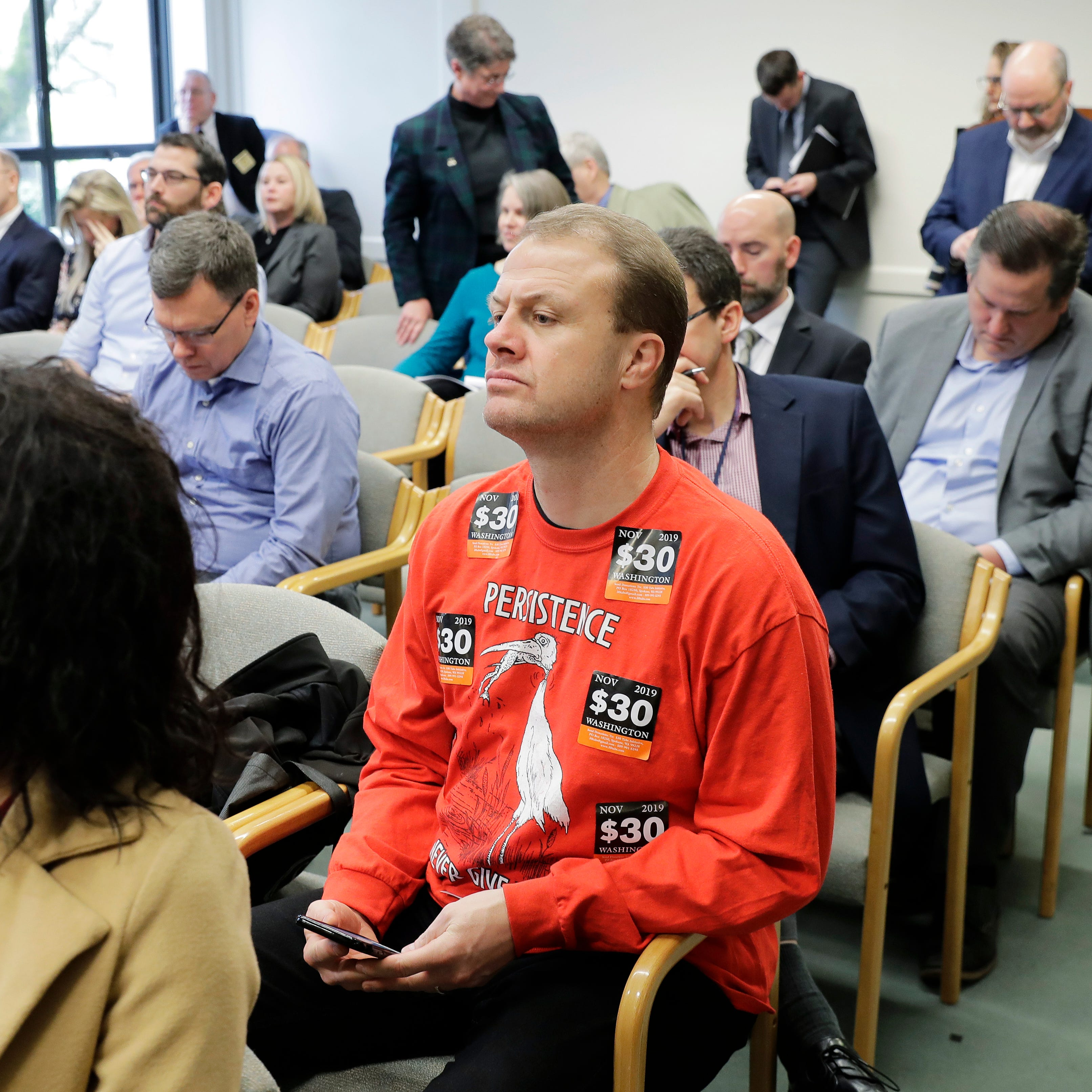 Tim Eyman charged with stealing chair, says it was a mistake