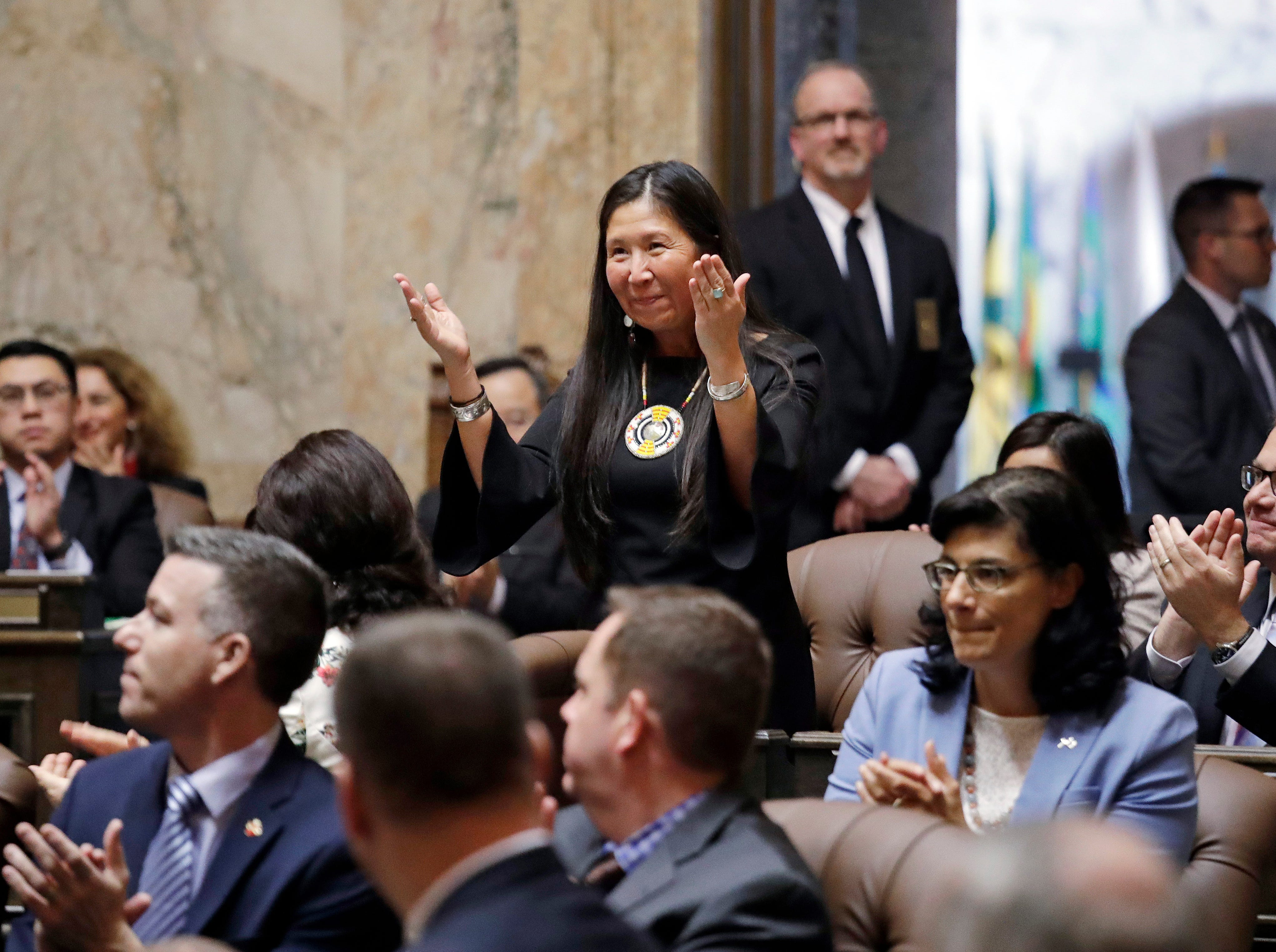 Rep. Debra Lekanoff, D-Bow, gives a traditional Native American greeting as she is introduced by Gov. Jay Inslee during his State of the State address Tuesday in Olympia.