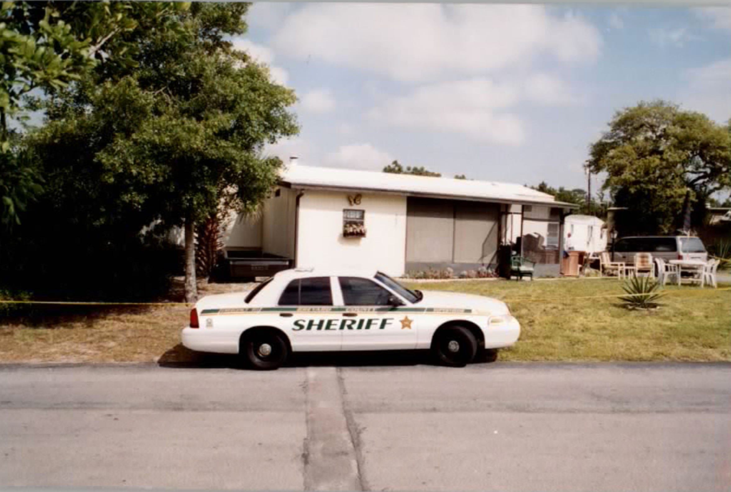 "A Brevard Sheriff's Department cruiser is parked at Mobileland-by-the-sea following the 2002 murder of Cortney ""Dick"" Crandall."