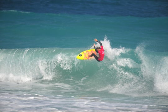 Surfer Chauncey Robinson of Floridana  Beach competes on the opening day of the $15,000 men's Florida Pro at Sebastian Inlet.
