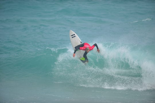 Surfer Tommy Coleman of Vero Beach competes on the opening day of the $15,000 men's Florida Pro at Sebastian Inlet.