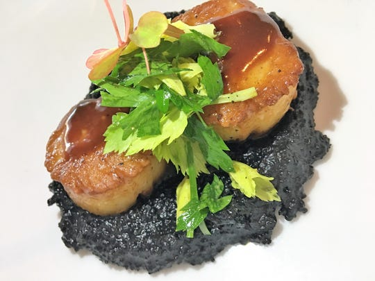 The Fat Snook in Cocoa Beach also recieved high praise for its innovative, ever-changing menu that includes dishes such as these jumbo scallops served over squid ink polenta.