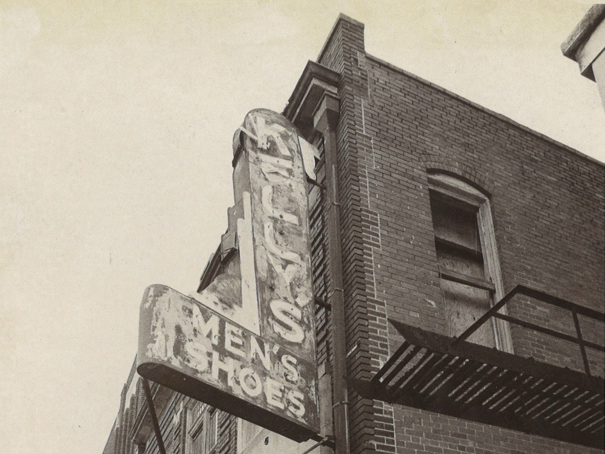 The boarded-up exterior of Kelly's Men's Shoes on Chaparral street in September 1975 in downtown Corpus Christi