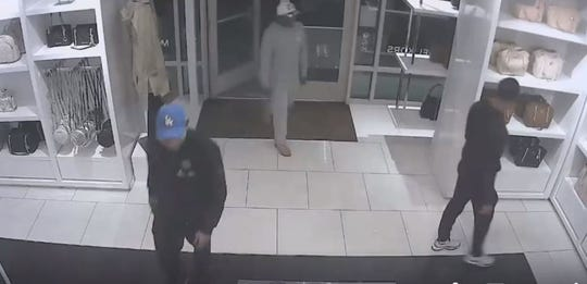 Police need the public to identify three men who allegedly robbed a Michael Kors store in Gloucester Township in October. The still is from a surveillance video posted to Facebook by Gloucester Township Police.