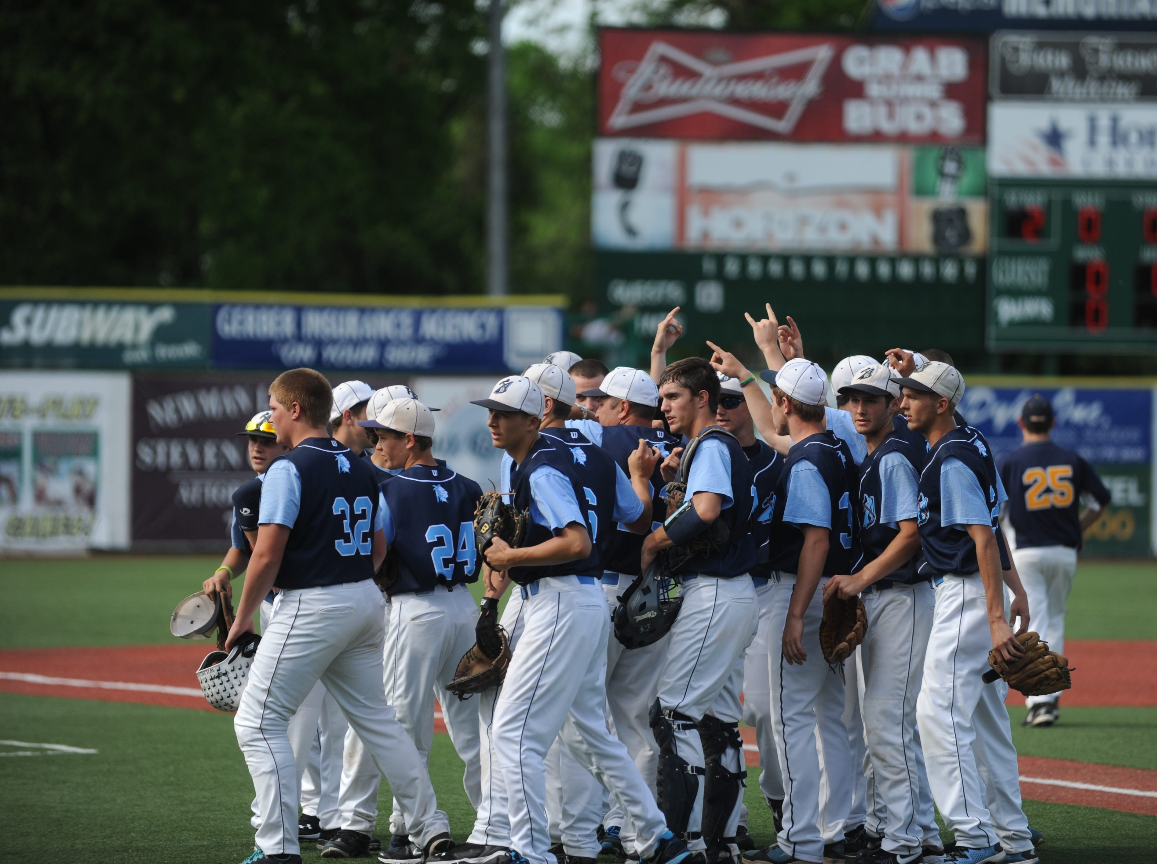 The Adena baseball team celebrate after scoring against South Point High School in a Division III district semifinal at V.A. Memorial stadium on Thursday, May 22, 2014. With a 7-1 win over Southpoint, the Warriors went on to participate in their third straight district final.