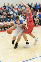Junior Nick Nesser drives past a Johnstown Monroe player Tuesday night at Zane Trace High school during the final half of the game.