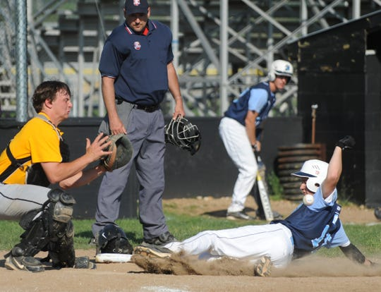 Adena's Eli Kunkel 18 slides safely into home to score ahead of the throw to Paint Valley's Mark Clifford in the second inning of a game at Paint Valley High School.