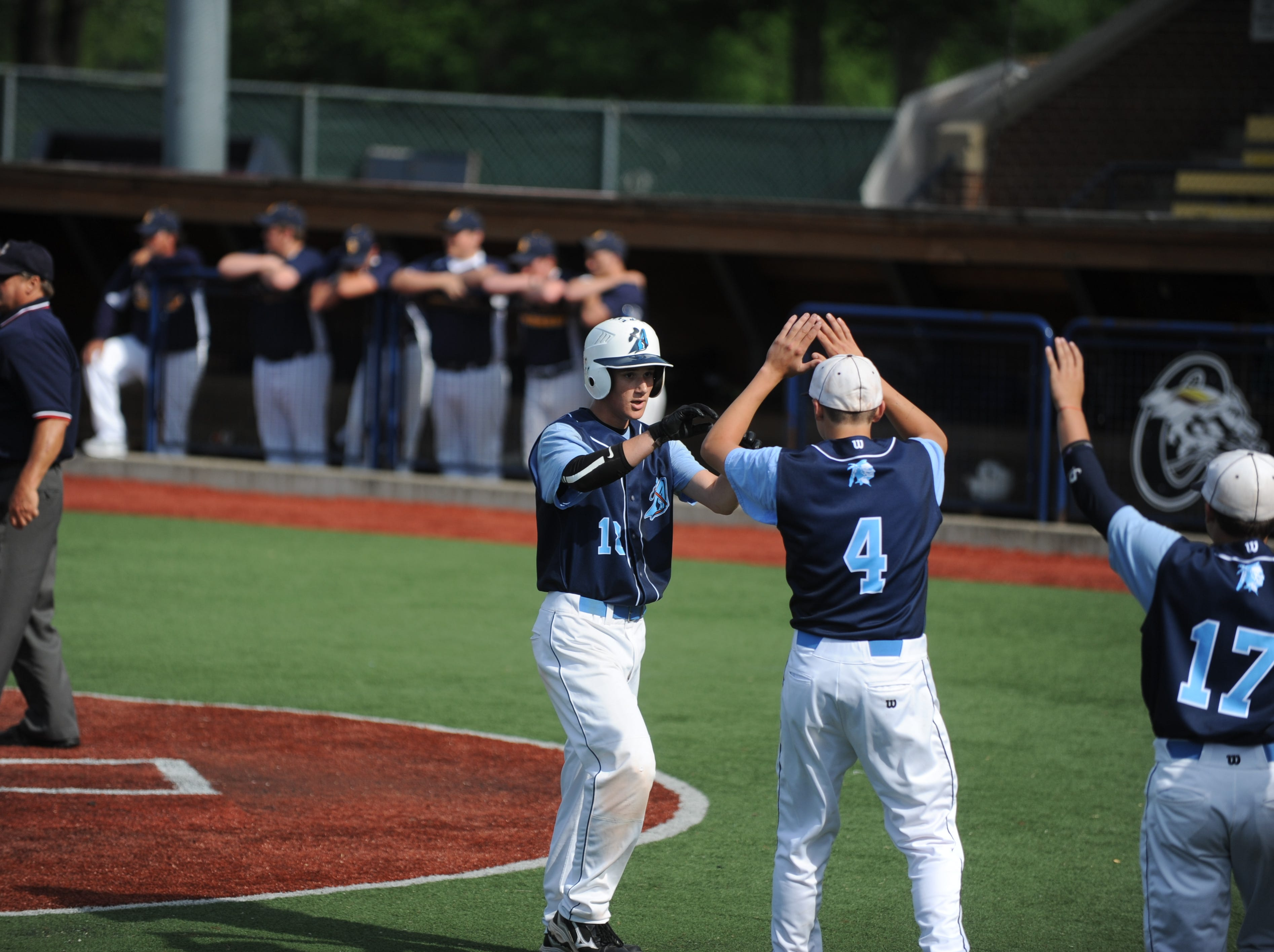 The Adena baseball team defeated South Point High School in a Division III district semifinal at V.A. Memorial stadium on Thursday, May 22, 2014. With a 7-1 win over Southpoint, the Warriors went on to participate in their third straight district final.