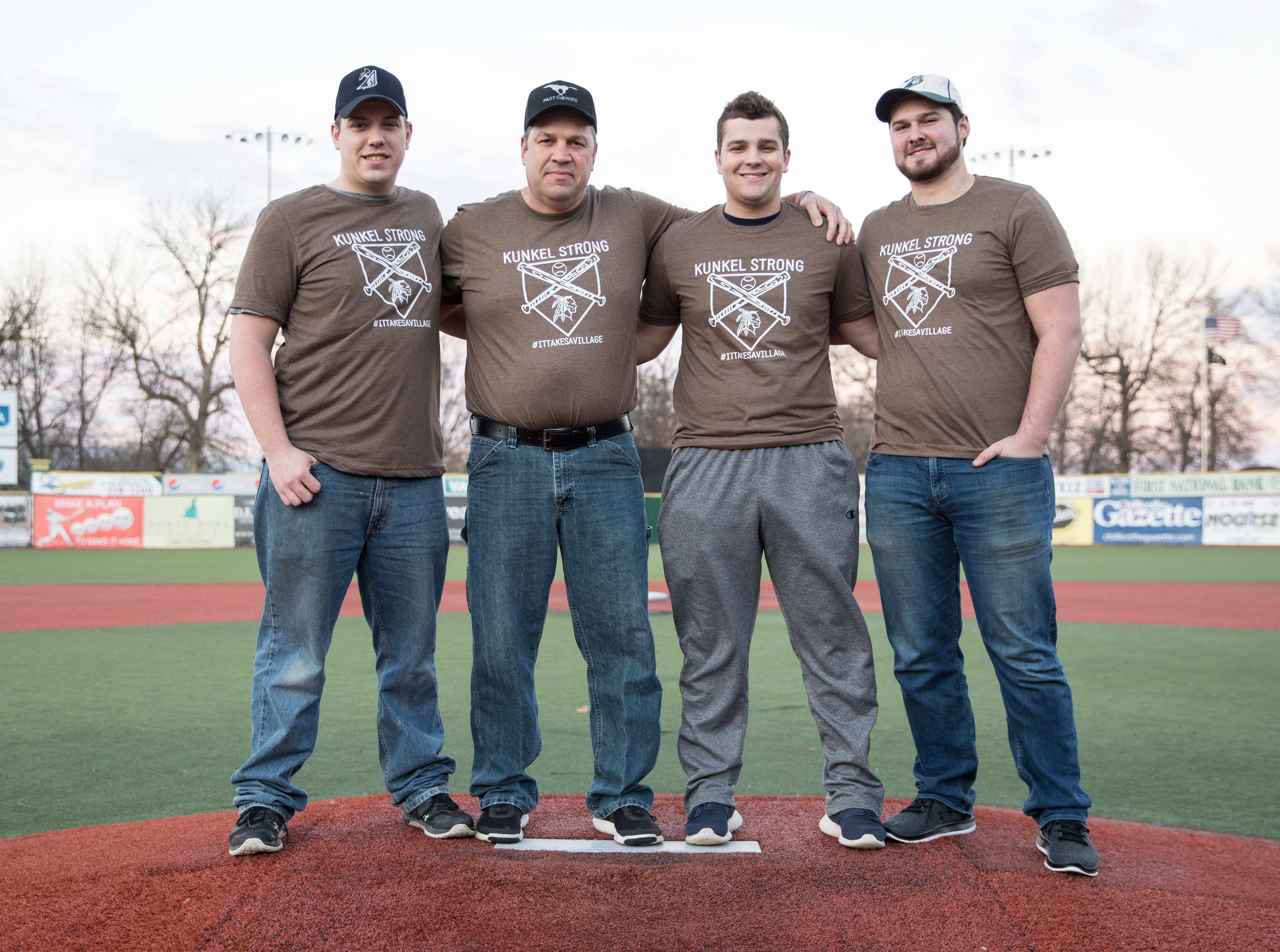 Former coach and teammates of Eli Kunkel stand on the pitcher's mound at the VA Memorial Stadium in Chillicothe, Ohio, were Kunkel and his team mates occasionally played baseball. (L-R) Nick Chester, Ron Free, Gunnar Free, and Andrew Woods.