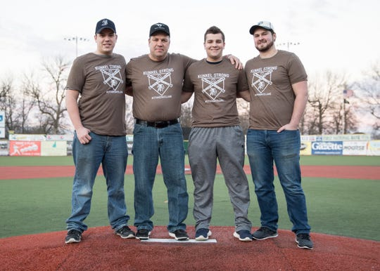 Former coach and teammates of Eli Kunkel stand on the pitcher's mound at the VA Memorial Stadium in Chillicothe, Ohio. (L-R) Nick Chester, Ron Free, Gunnar Free, and Andrew Woods.