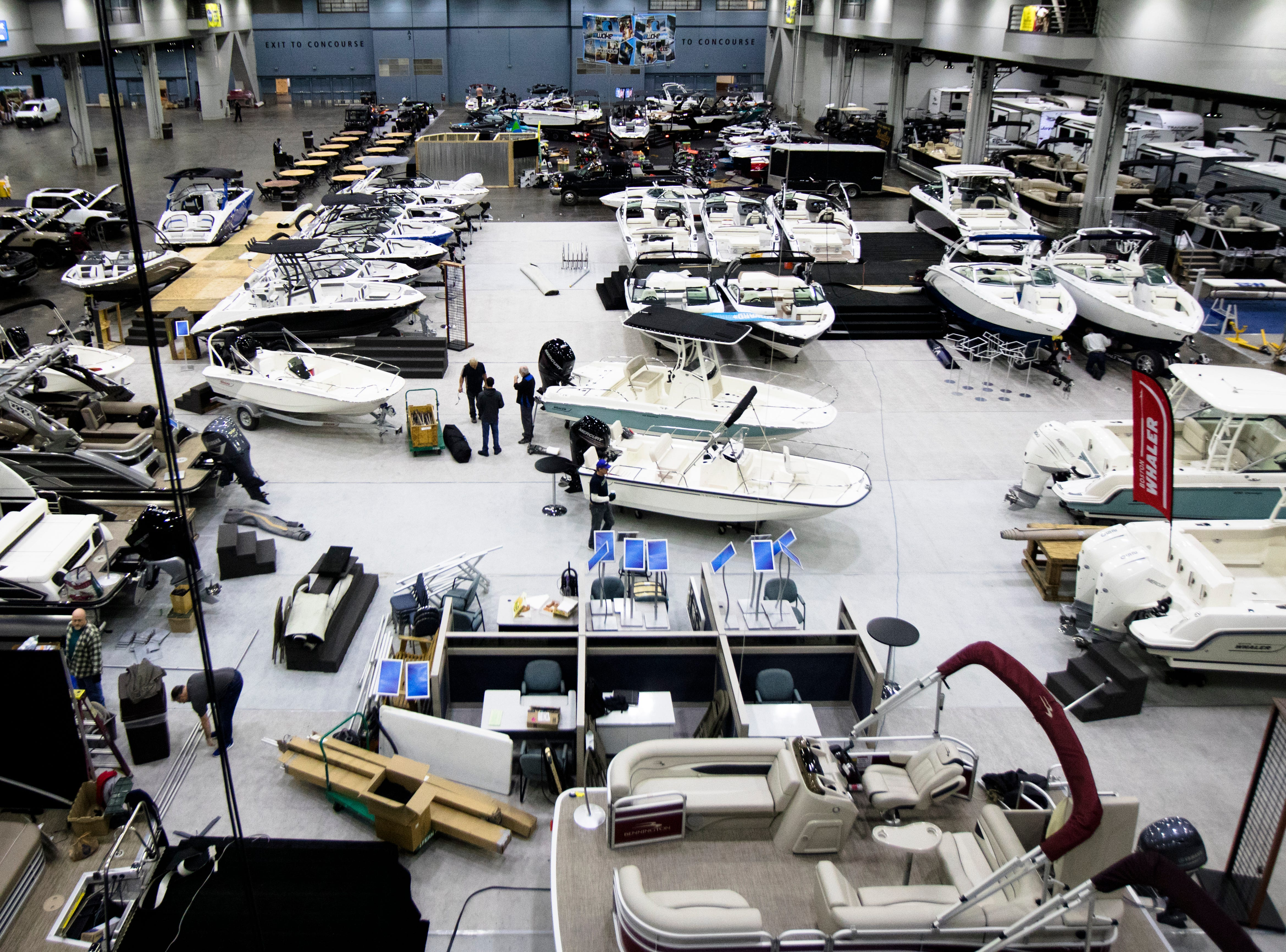 Workers prepare for the annual Cincinnati Travel Sports and Boat Show on Wednesday, Jan. 16, 2018 at the Duke Energy Convention Center in Downtown Cincinnati.