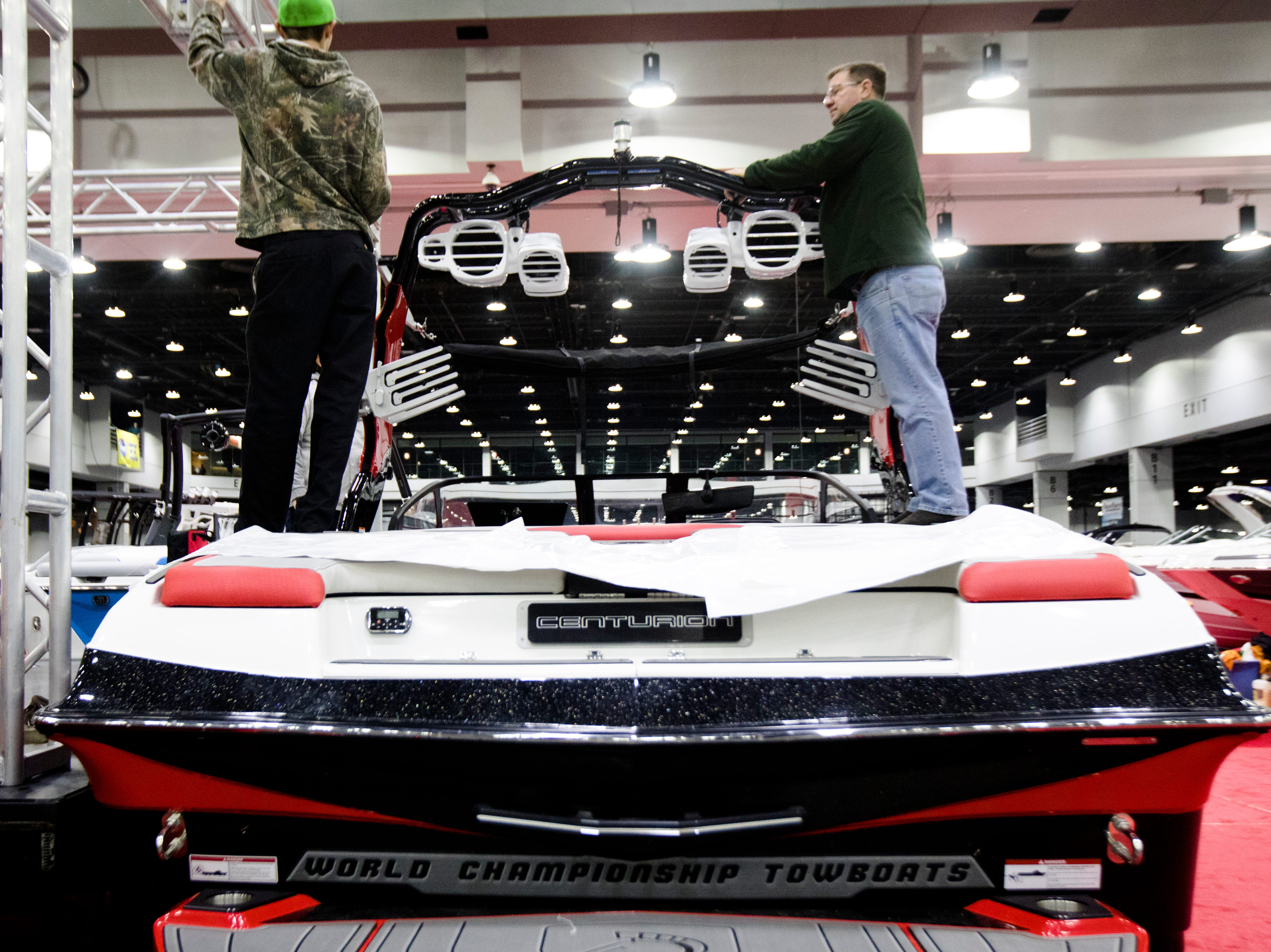 People work setting up the Centurion at the annual Cincinnati Travel Sports and Boat Show on Wednesday, Jan. 16, 2018 at the Duke Energy Convention Center in Downtown Cincinnati.