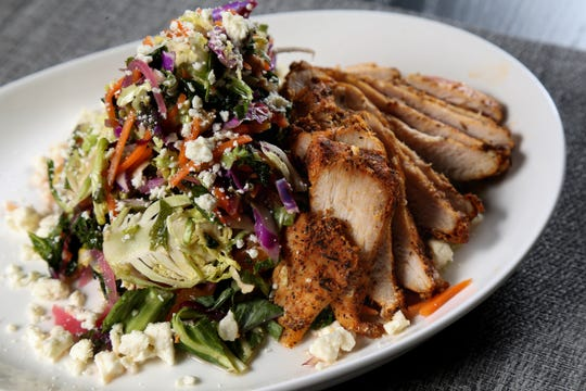 The shaved Brussels sprouts salad with chicken, featuring pickled red onion, almonds, roasted carrots, dried apricots, feta and citrus emulsion, pictured, Tuesday, Jan. 15, 2019, at Galla Park restaurant at The Banks in Cincinnati.