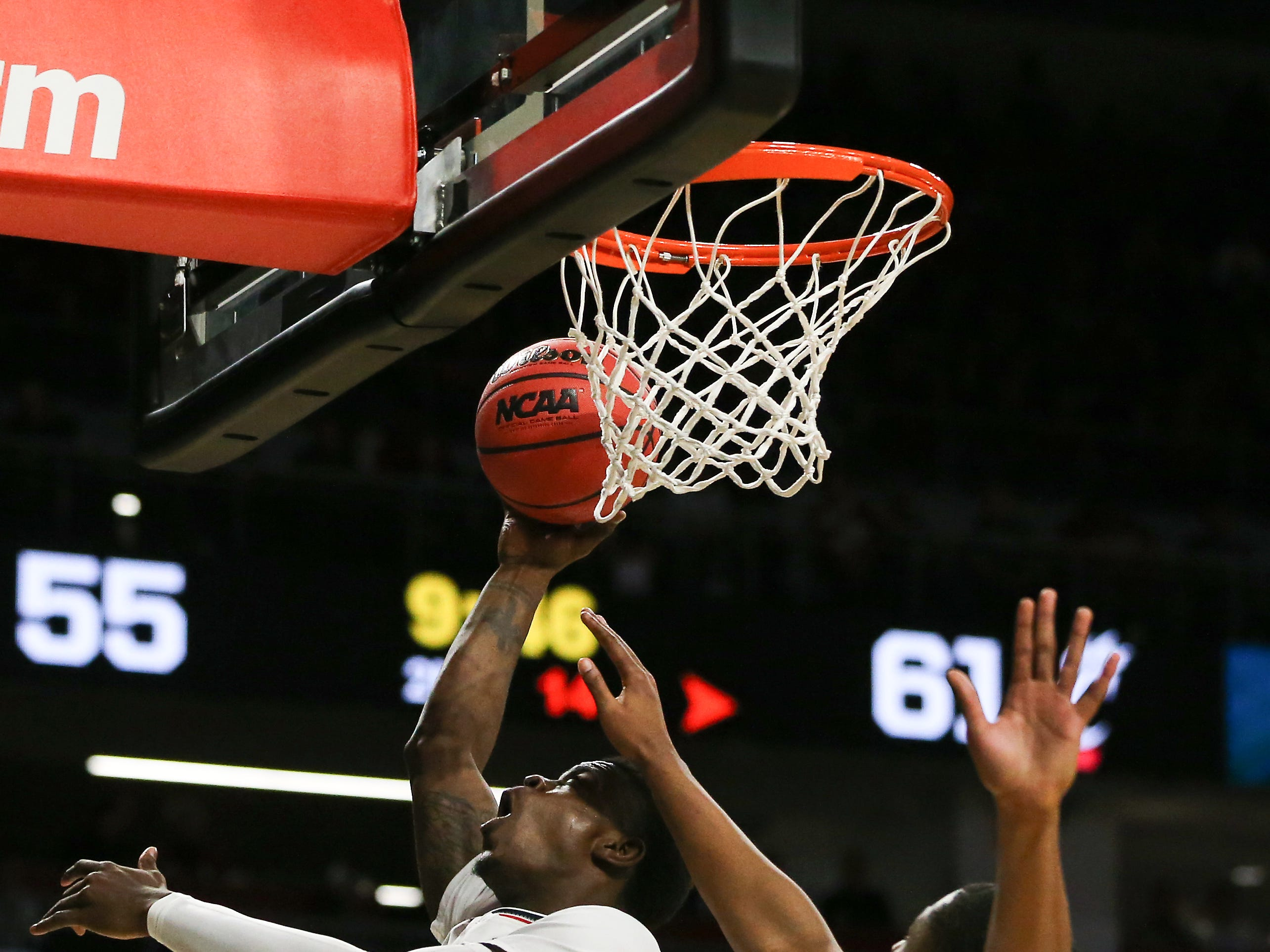 Cincinnati Bearcats forward Tre Scott (13) finishes at the basket in the second half of an NCAA college basketball game against the South Florida Bulls Tuesday, Jan. 15, 2019, at Fifth Third Arena in Cincinnati. Cincinnati won 82-74.