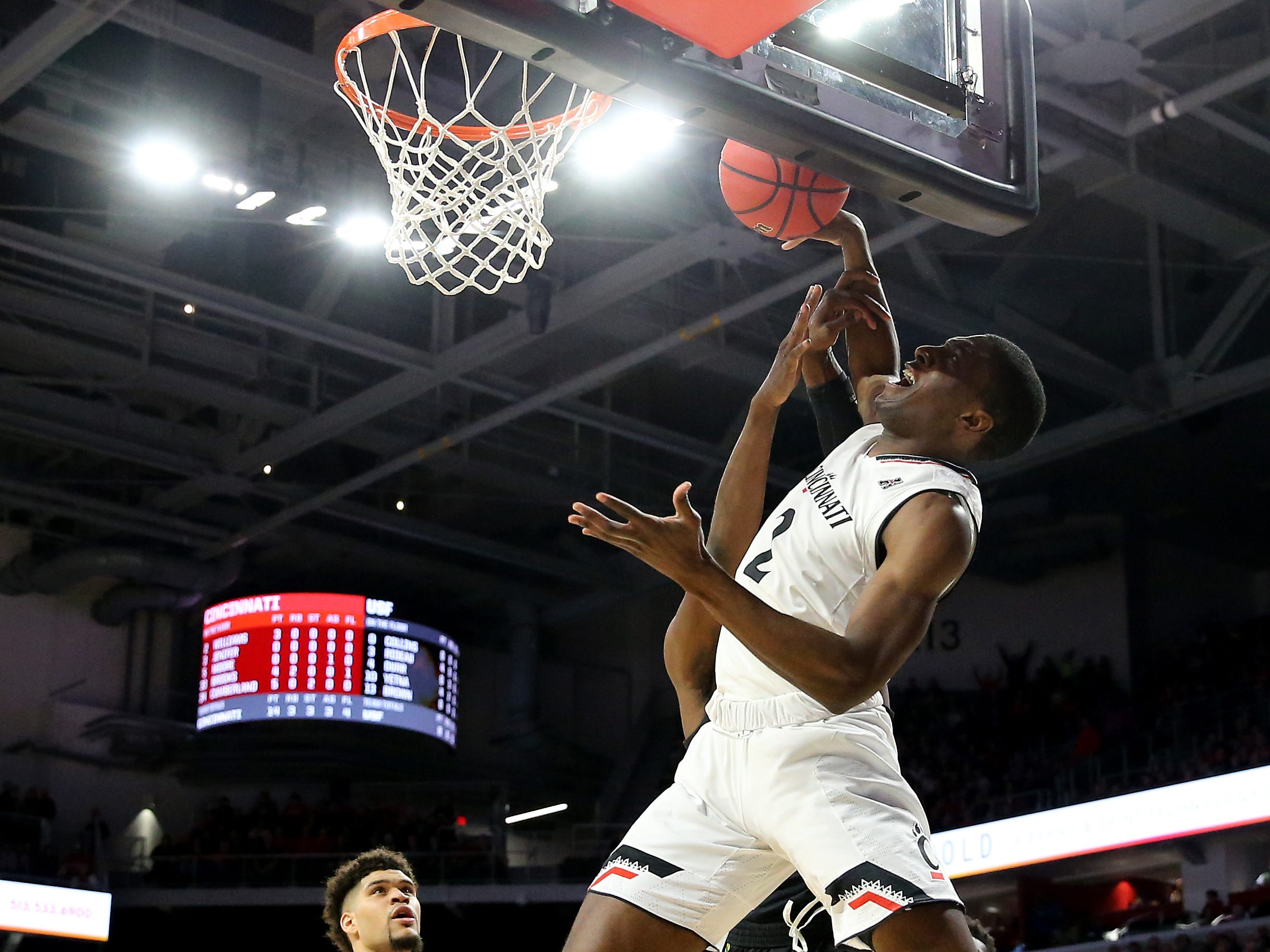 Cincinnati Bearcats guard Keith Williams (2) leaps for a rebound in the first half of an NCAA college basketball game against the South Florida Bulls, Tuesday, Jan. 15, 2019, at Fifth Third Arena in Cincinnati.