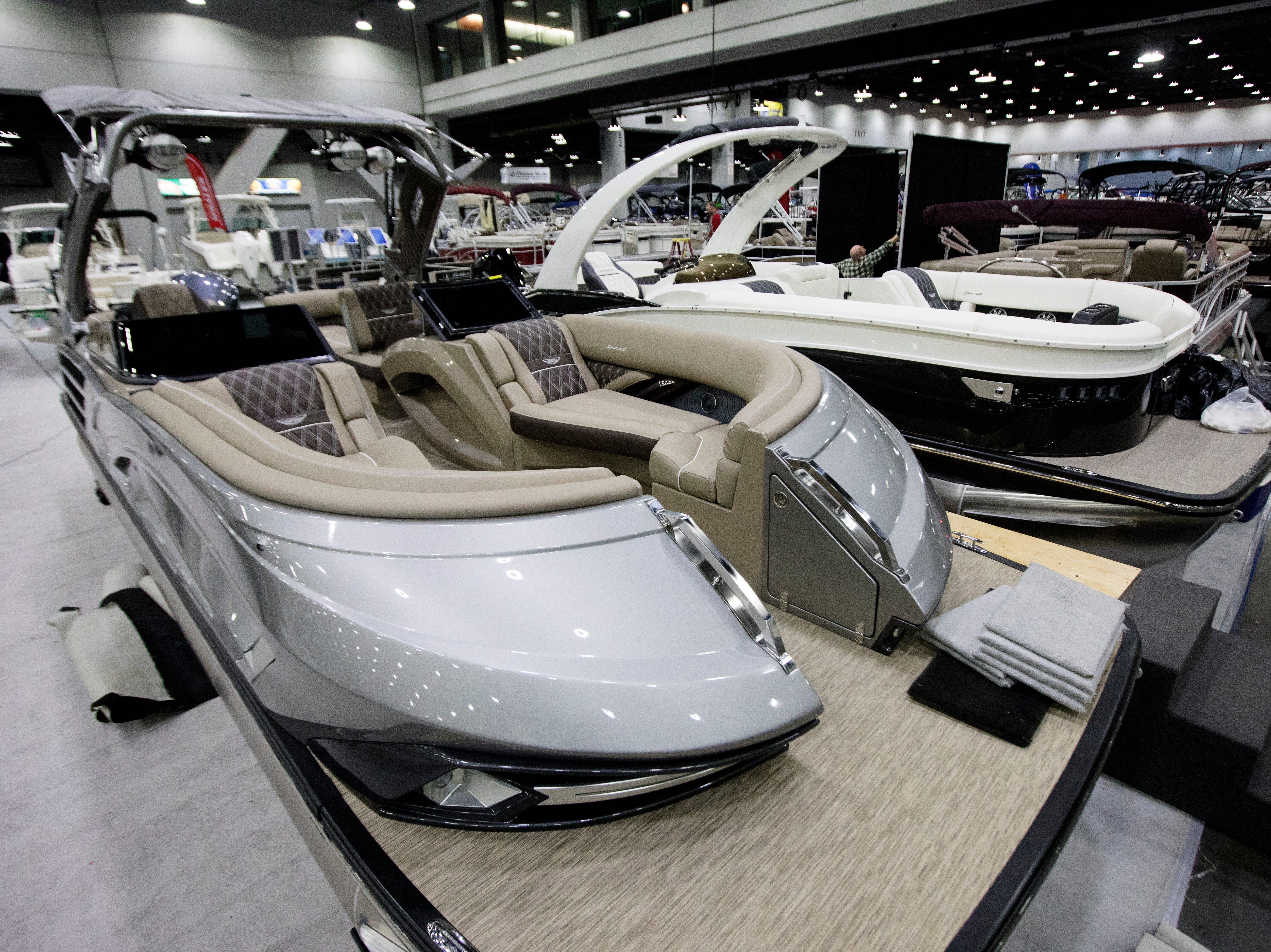 A view of the Bennington's premium 27 QX interior at the annual Cincinnati Travel Sports and Boat Show on Wednesday, Jan. 16, 2018 at the Duke Energy Convention Center in Downtown Cincinnati. The Bennignton's Premuim 27 QX MSRB is around $300,000.