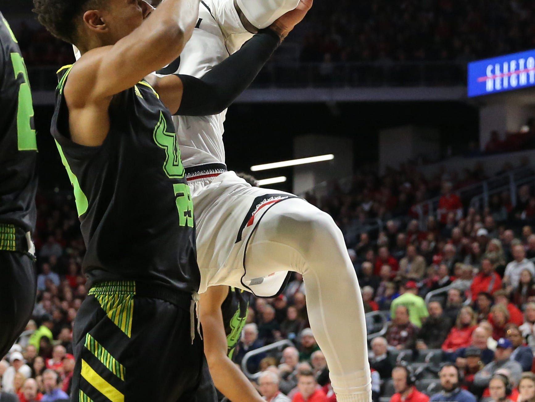 Cincinnati Bearcats forward Trevon Scott (13) pulls down a rebound in the first half of an NCAA college basketball game against the South Florida Bulls, Tuesday, Jan. 15, 2019, at Fifth Third Arena in Cincinnati.