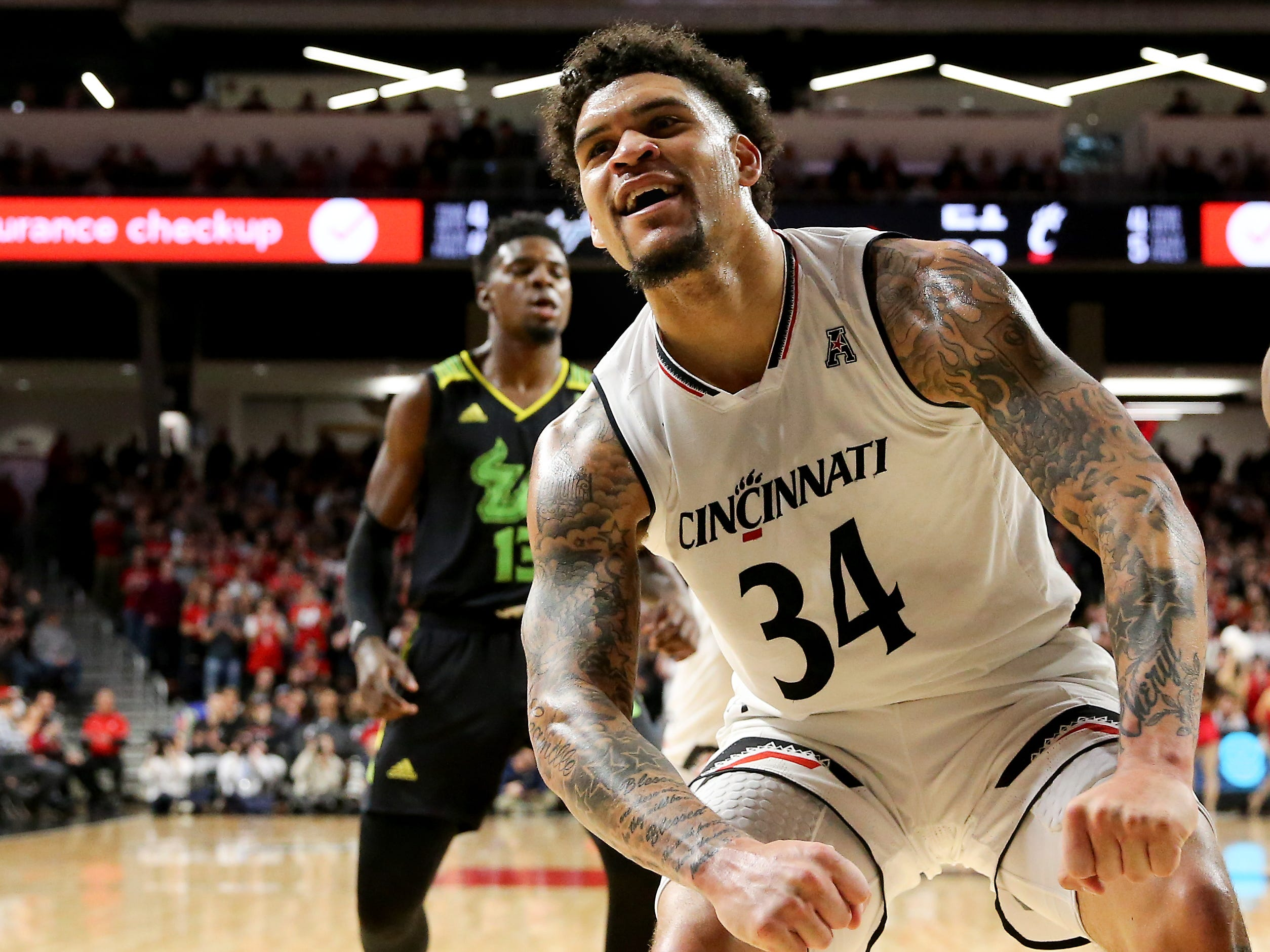 Cincinnati Bearcats guard Jarron Cumberland (34) reacts after a made basket in the first half of an NCAA college basketball game against the South Florida Bulls, Tuesday, Jan. 15, 2019, at Fifth Third Arena in Cincinnati.