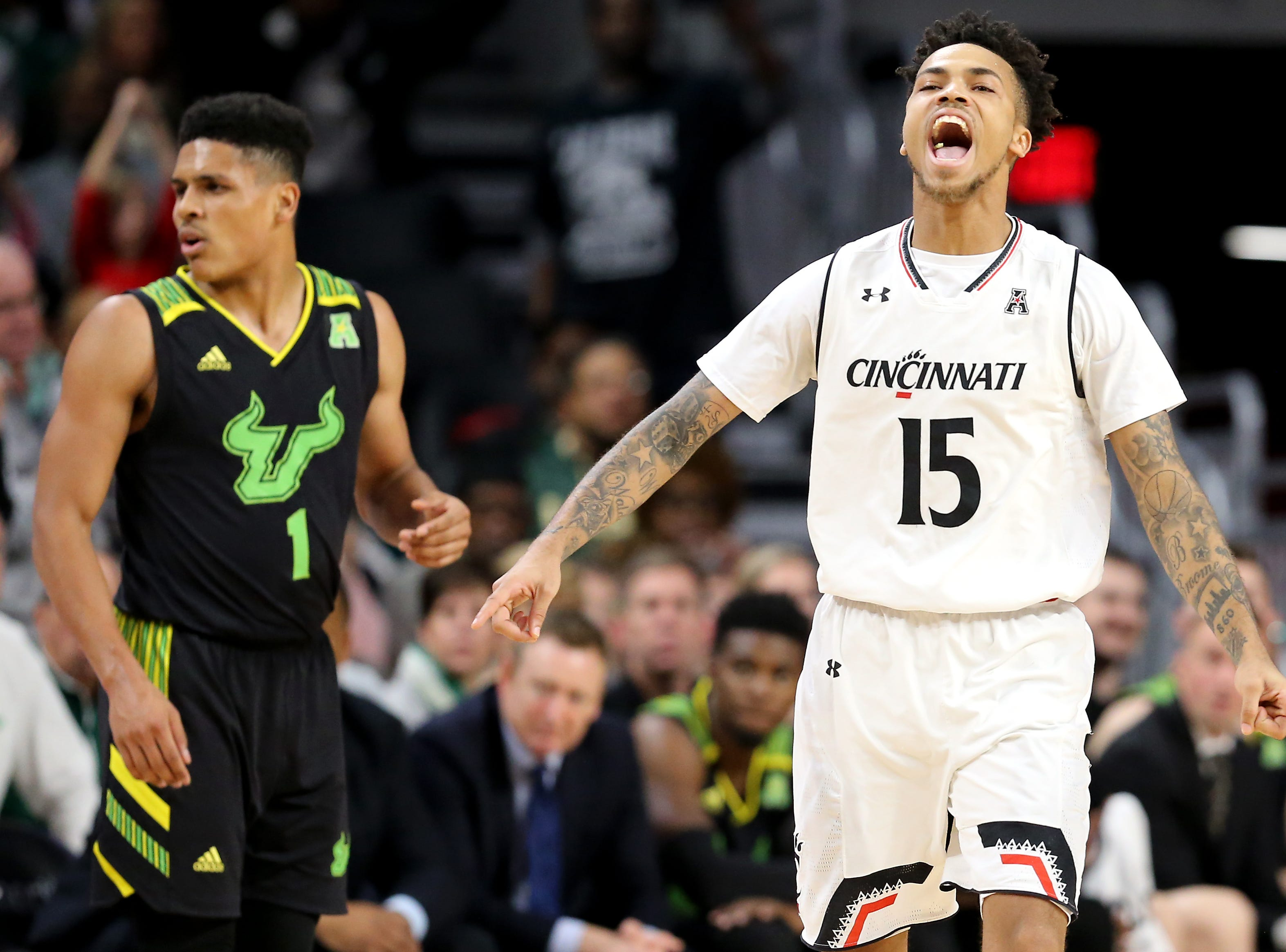 Cincinnati Bearcats guard Cane Broome (15) reacts when a timeout is called after Cincinnati went on an 8-0 run in the second half of an NCAA college basketball game against the South Florida Bulls, Tuesday, Jan. 15, 2019, at Fifth Third Arena in Cincinnati. Cincinnati won 82-74.