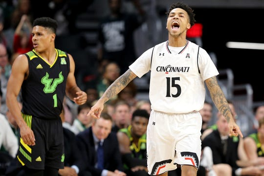 Cincinnati Bearcats guard Cane Broome (15)  hopes to celebrate again Thursday night against Tulsa. Broome forced overtime in the last contest scoring UC's final seven points.
