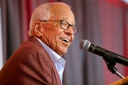 Marty Brennaman speaks at a press conference announcing his retirement on Jan. 16.