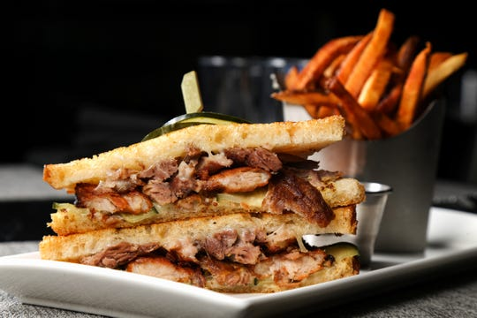 The Cuban sandwich, with braised pork, pork belly, house pickle, ale mustard Swiss cheese on a sourdough, pictured, Tuesday, Jan. 15, 2019,at Galla Park restaurant at The Banks in Cincinnati.