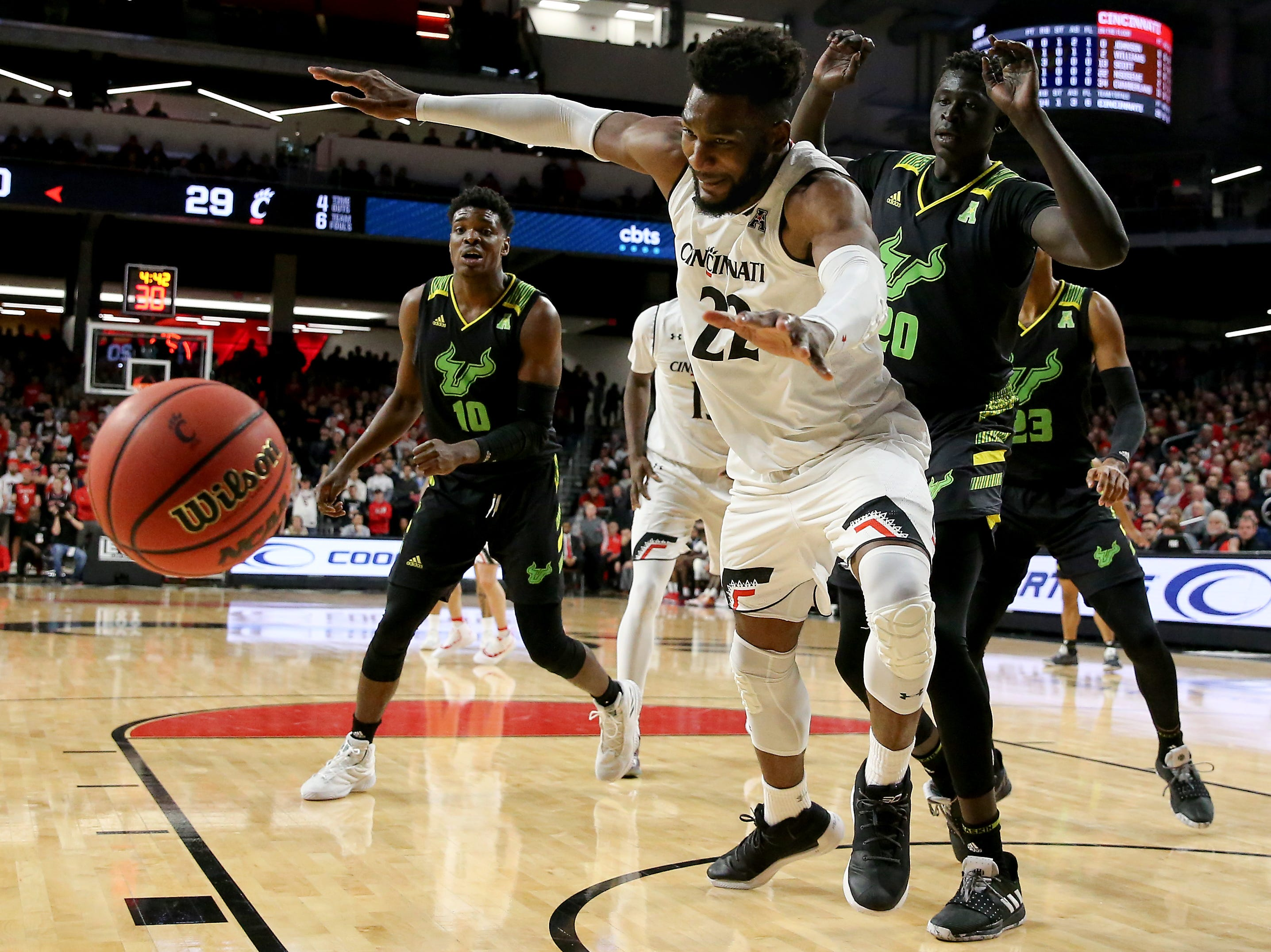 Cincinnati Bearcats forward Eliel Nsoseme (22) chases after a loose ball in the first half of an NCAA college basketball game against the South Florida Bulls, Tuesday, Jan. 15, 2019, at Fifth Third Arena in Cincinnati.