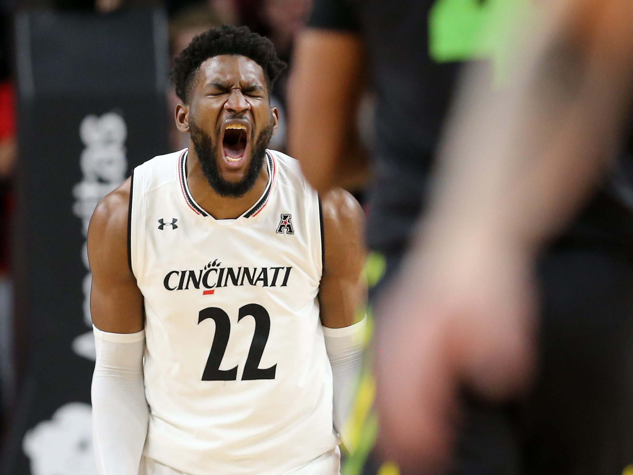 Cincinnati Bearcats forward Eliel Nsoseme (22) reacts after a made a basket in the first half of an NCAA college basketball game against the South Florida Bulls, Tuesday, Jan. 15, 2019, at Fifth Third Arena in Cincinnati.