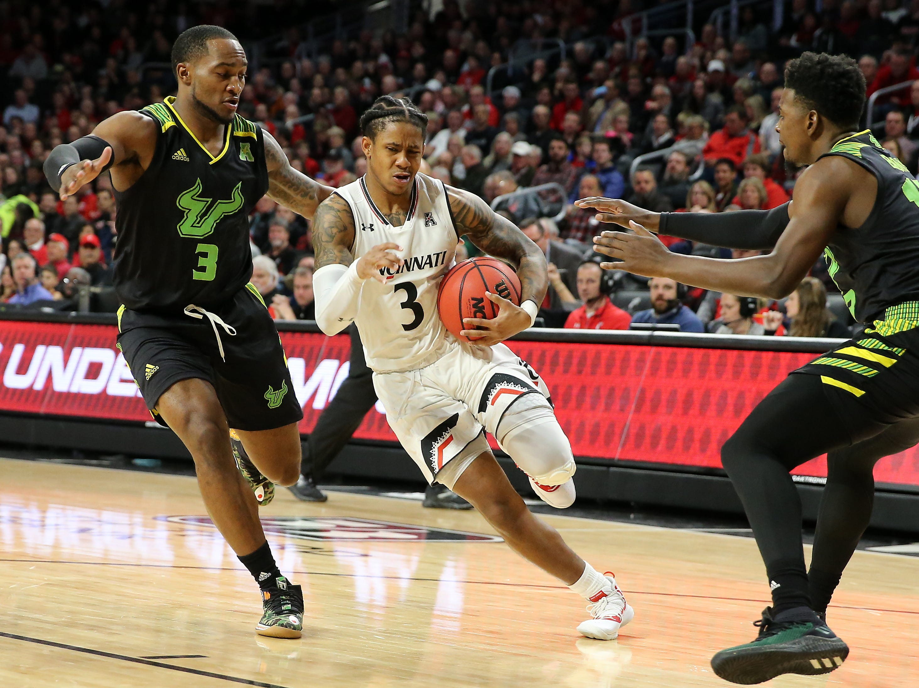 Cincinnati Bearcats guard Justin Jenifer (3) drives to the basket as South Florida Bulls guard LaQuincy Rideau (3) defends in the first half of an NCAA college basketball game, Tuesday, Jan. 15, 2019, at Fifth Third Arena in Cincinnati.