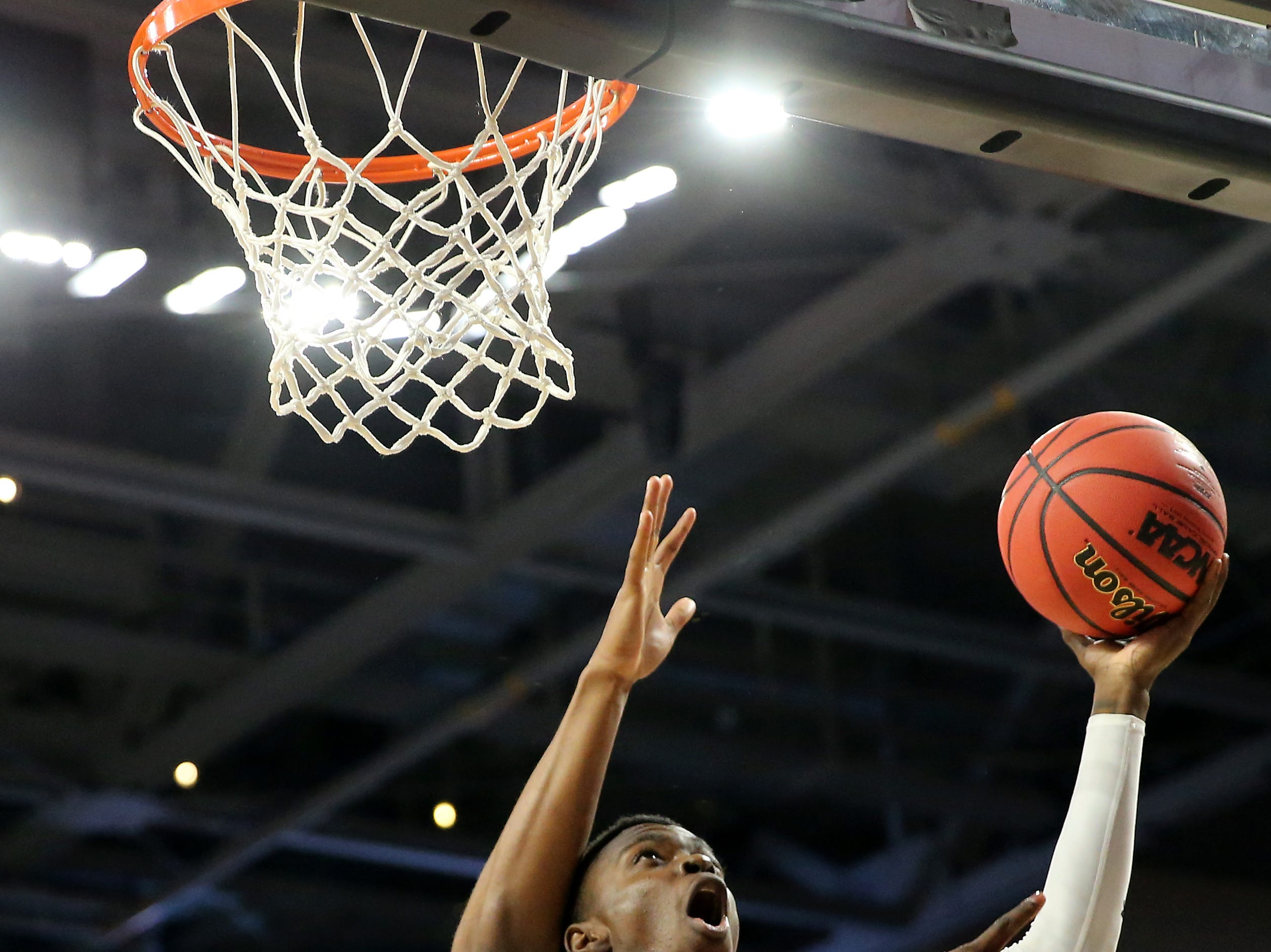 Cincinnati Bearcats forward Tre Scott (13) scores in the first half of an NCAA college basketball game against the South Florida Bulls, Tuesday, Jan. 15, 2019, at Fifth Third Arena in Cincinnati.