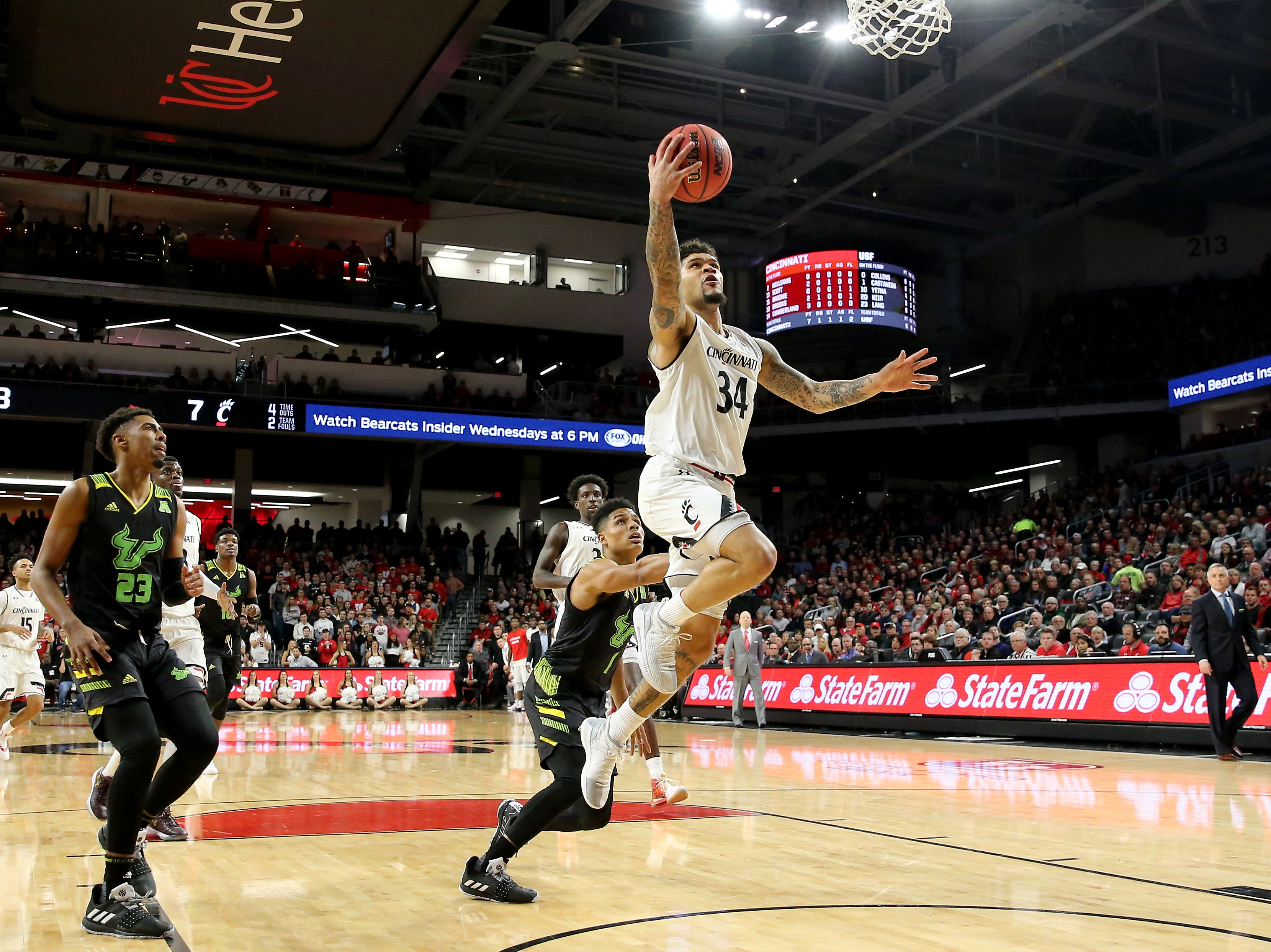 Cincinnati Bearcats guard Jarron Cumberland (34) goes up for a layup in the first half of an NCAA college basketball game against the South Florida Bulls, Tuesday, Jan. 15, 2019, at Fifth Third Arena in Cincinnati.
