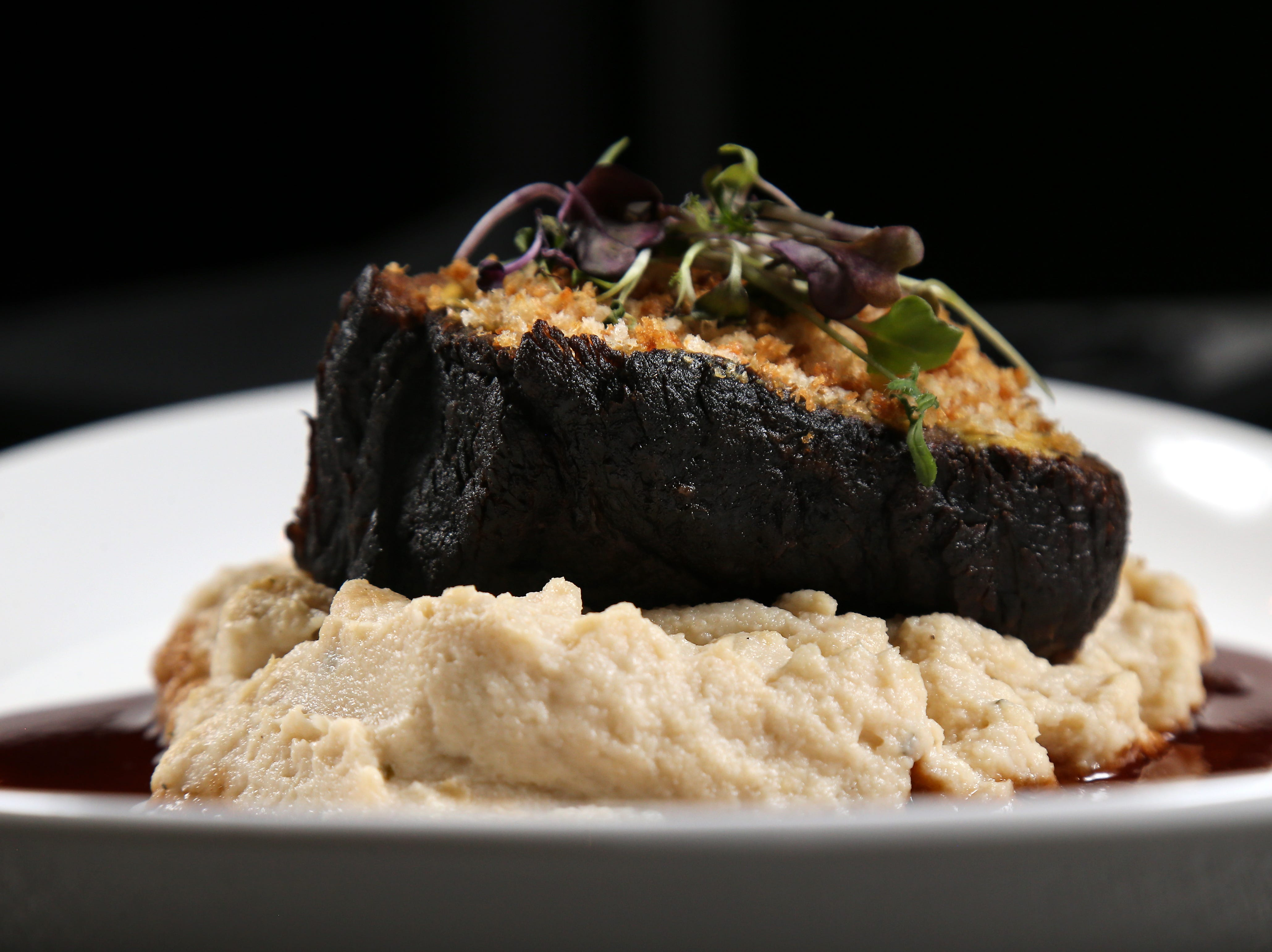 The beef short rib with sharp cheddar, giardiniera and parmesan crusted bread, pictured, Tuesday, Jan. 15, 2019,at Galla Park restaurant at The Banks in Cincinnati.