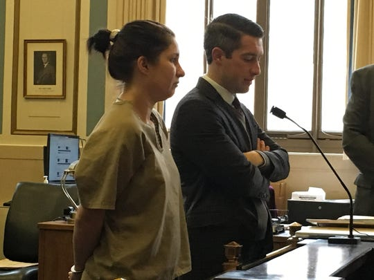 Kathryn Carmen, at left, stands next to her attorney, John Kennedy, at her sentencing Wednesday, Jan. 16, 2019, in Hamilton County Common Pleas Court.