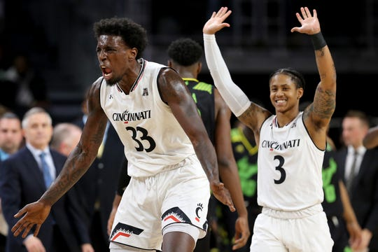 Cincinnati Bearcats center Nysier Brooks (33) and Cincinnati Bearcats guard Justin Jenifer (3) celebrate a lead after a timeout is called in the second half of an NCAA college basketball game against the South Florida Bulls, Tuesday, Jan. 15, 2019, at Fifth Third Arena in Cincinnati. Cincinnati won 82-74. UC hopes to continue their AAC win streak Saturday at Wichita State.