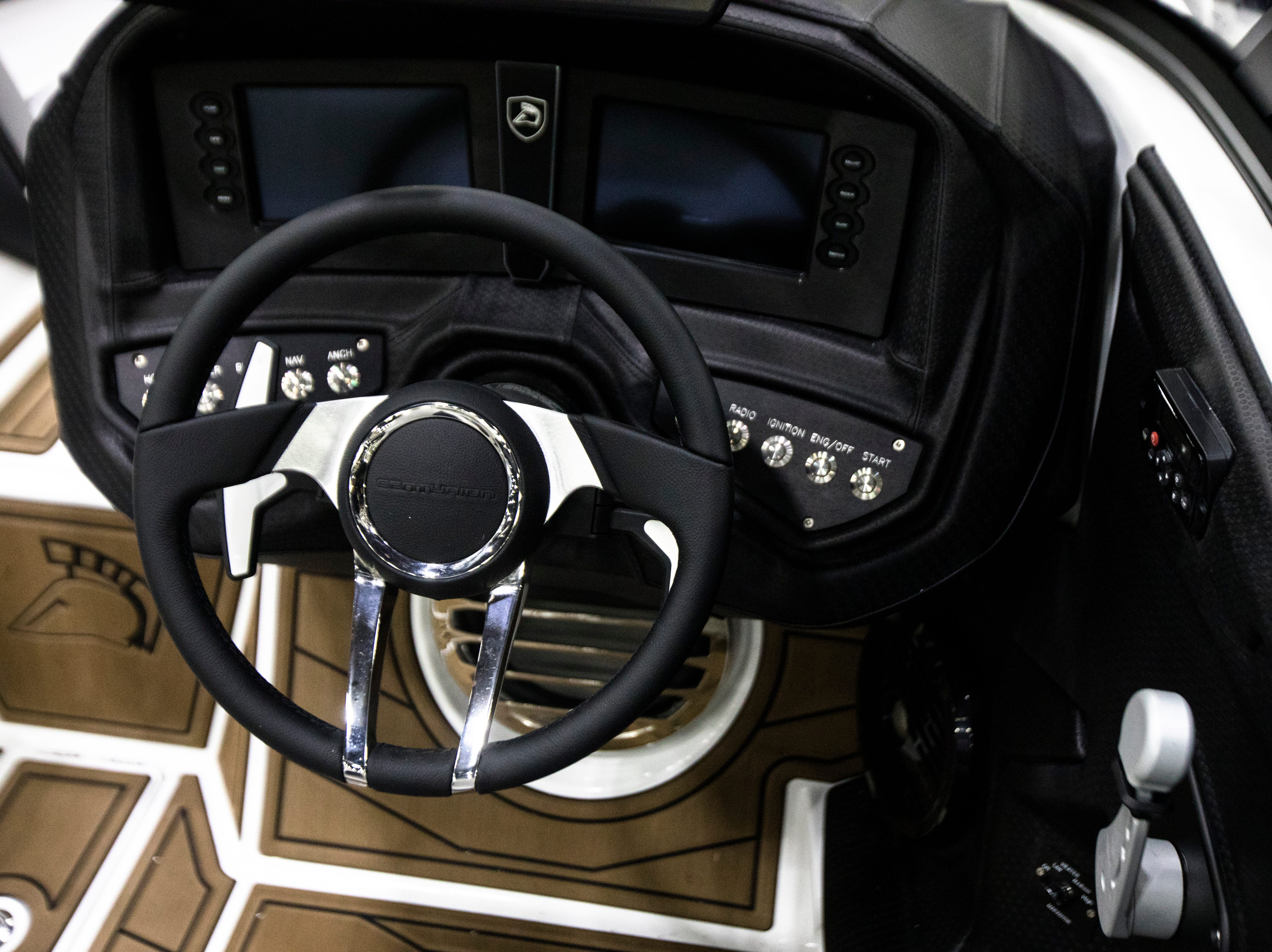 A view of the Centurion Ri257 steering wheel at the annual Cincinnati Travel Sports and Boat Show on Wednesday, Jan. 16, 2018 at the Duke Energy Convention Center in Downtown Cincinnati. According to the manufacturer the MSRB on the Centurion Ri257 is around $205,000.