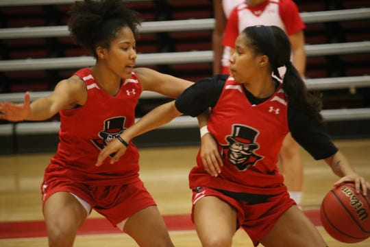 Austin Peay's Ferby sisters – Brianah, left, and Brandi, right – compete against each other during practice Tuesday.