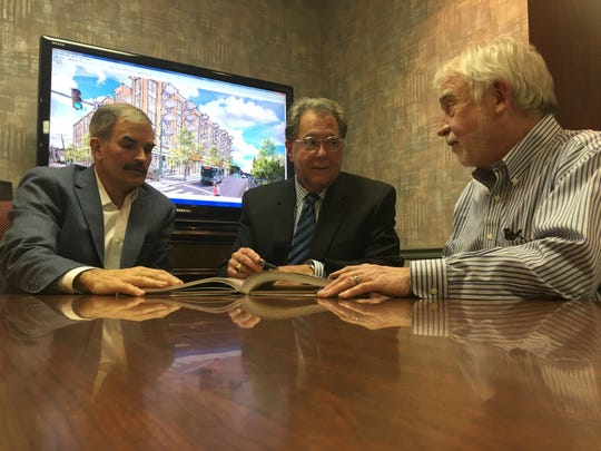 Two Rivers Company leaders Charlie Koon, left, Jeff Bibb and Charlie Foust talk about the future of downtown Clarksville, 20 years after the tornado.