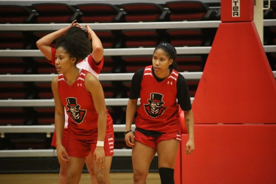 Austin Peay's Brianah Ferby (left) and Brandi Ferby watch teammtes go through drills during practice Tuesday at the Dunn Center.