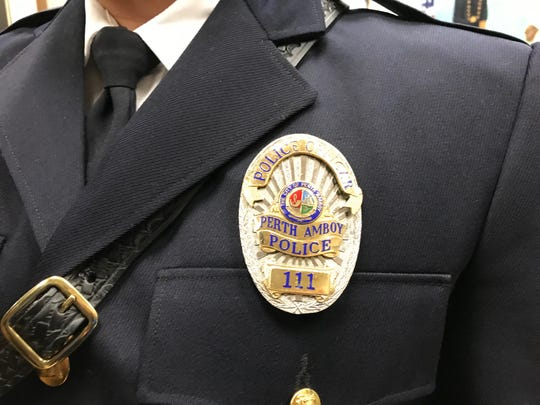 Officer Leonel Tejera's badge No. 111, the same as retired officer Kenneth Puccio's.