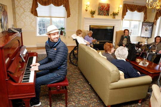"""Ryan Brolliar, who is on his """"Music is Medicine Tour,"""" playing piano his piano for Chelsea residents and staff."""