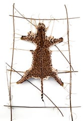 "Ruth Marshall, ""Ocelot #6,"" (2010) hand-knitted textile with string and sticks"