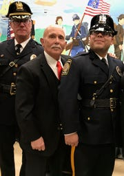 Acting Perth Amboy Police Chief Roman McKeon (left), retired Officer Kenneth Puccio (center) and newly sworn in Officer Leonel Tejera.
