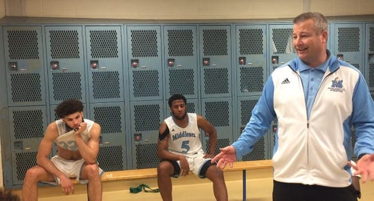 Dave Turco addresses his team in the locker room on Tuesday night