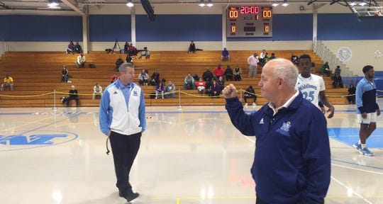 Dave Turco (left) and assistant coach Bill Kilduff await the start of Tuesday's game.