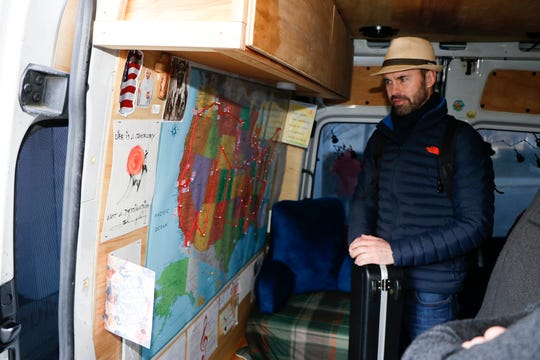 Ryan Brolliar shows his tour map inside the Jambulance
