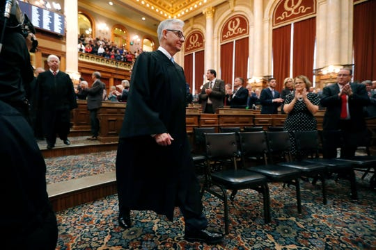 Iowa Supreme Court Chief Justice Mark Cady enters the Iowa House chambers to listen to Iowa Gov. Kim Reynolds deliver her Condition of the State address before a joint session of the Iowa Legislature, Tuesday, Jan. 15, 2019, at the Statehouse in Des Moines, Iowa. (AP Photo/Charlie Neibergall)