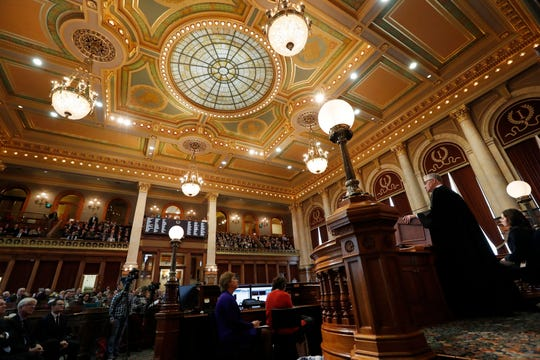 Iowa Supreme Court Chief Justice Mark Cady, right, delivers his Condition of the Judiciary address to a joint session of the Iowa Legislature, Wednesday, Jan. 16, 2019, at the Statehouse in Des Moines, Iowa. (AP Photo/Charlie Neibergall)